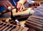Most cigars are composed primarily  of a single type of tobacco (air-cured and fermented tobacco), and they  have a tobacco wrapper.  They can contain between 1 gram and 20 grams of  tobacco.